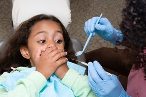 Scared child at dentist